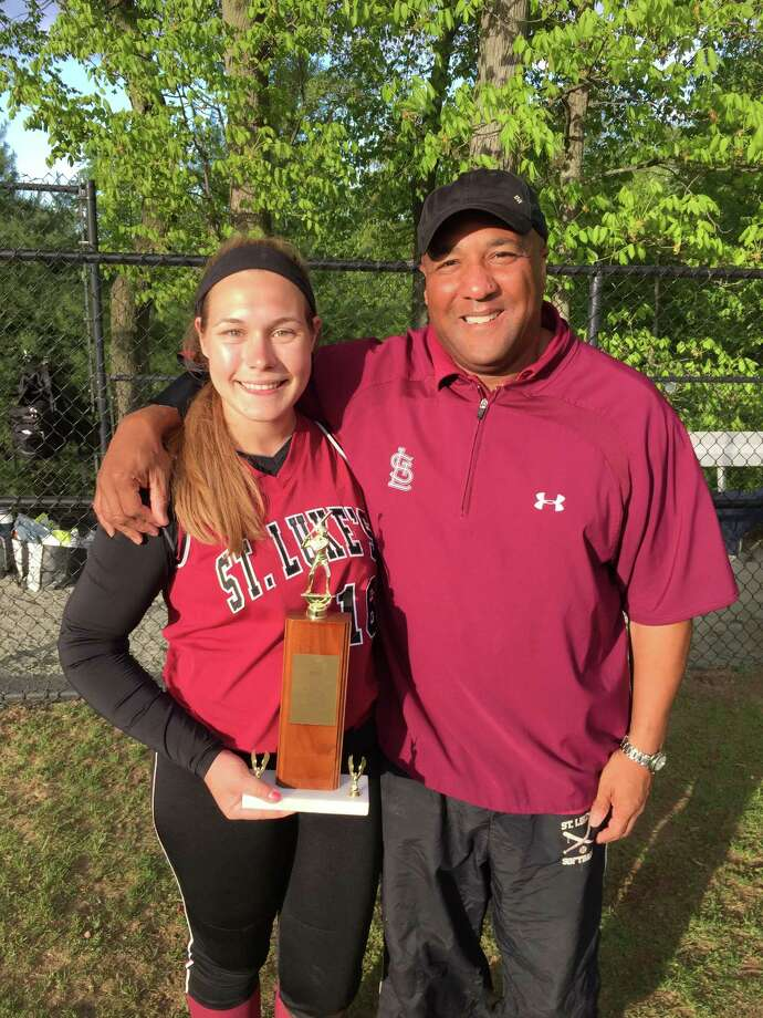 Marissa Ruschil, a senior, was the winning pitcher in St. Luke's 2-1 FAA title win; she also collected an RBI.Ruschil is pitcured with the trophy and coach Troy Haynie. Photo: Desiree Smock / New Canaan News