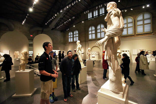 """In this 2013 photo, """"The Lansdowne Trajan"""" a Roman statue draws much attention as visitors fill the Gilbert Denman Gallery for Ancient Sculpture at the San Antonio Museum of Art."""