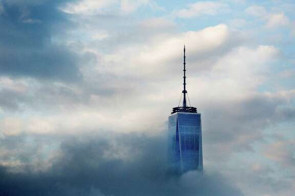 This April 21, 2015, file photo, shows the top floors of New York's One World Trade Center in Lower Manhattan. The observatory atop the 104-story skyscraper is scheduled to open to the public on May 29.  (AP Photo/Mark Lennihan, File) ORG XMIT: NYR201