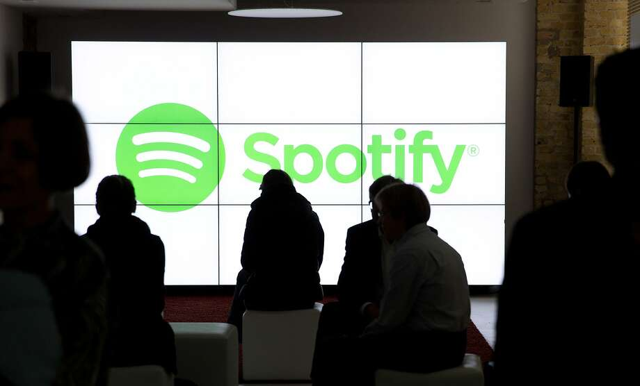 People in Berlin wait for the start of a May event by Spotify, the world leader in music streaming. Photo: J(div)RG CARSTENSEN, AFP / Getty Images