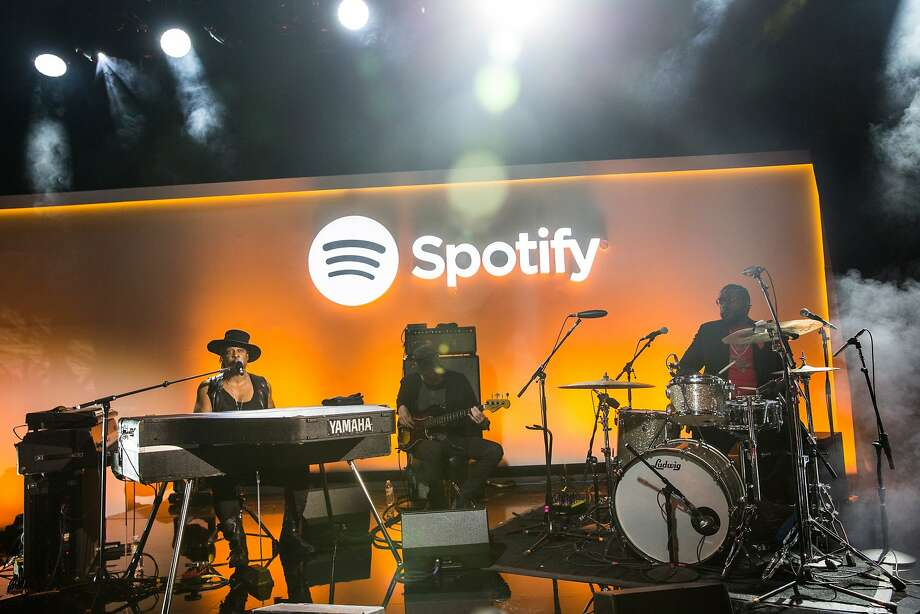 Musician D'Angelo (left) plays a private concert at a May media event announcing updates to Spotify, including the ability to stream video content. Photo: Andrew Burton, Getty Images