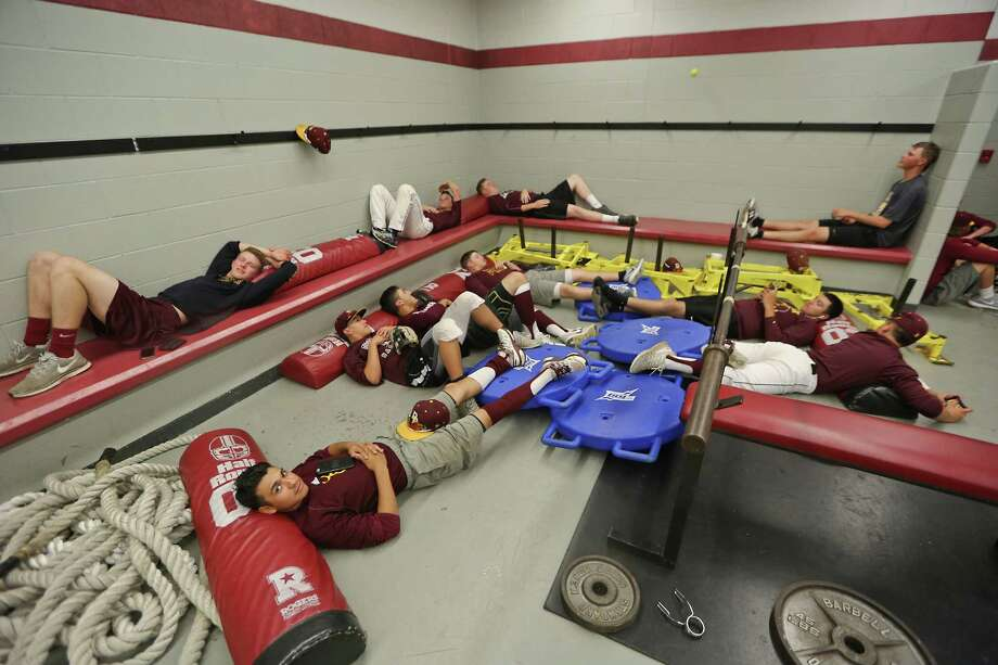 Deer Park Baseball Players Relax In Their Locker Room During A Rain Delay While Waiting To