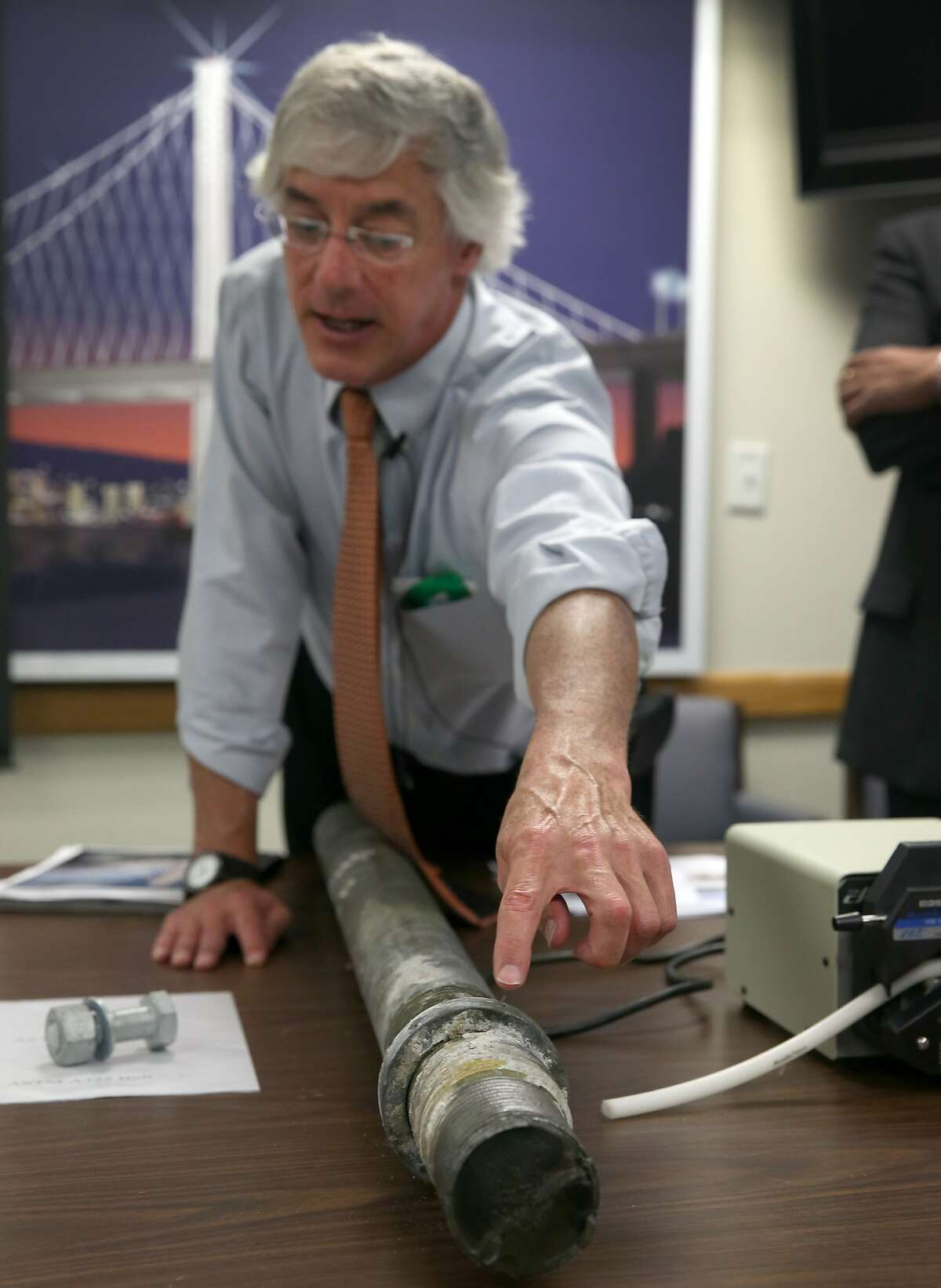 Caltrans engineer Brian Maroney displays a three-inch rod which was found to be broken from the base of the SAS tower of the new Bay Bridge, during a news conference in Oakland, Calif. on Wednesday, May 20, 2015. The rod was removed from the tower and will be sent to a lab for analysis.