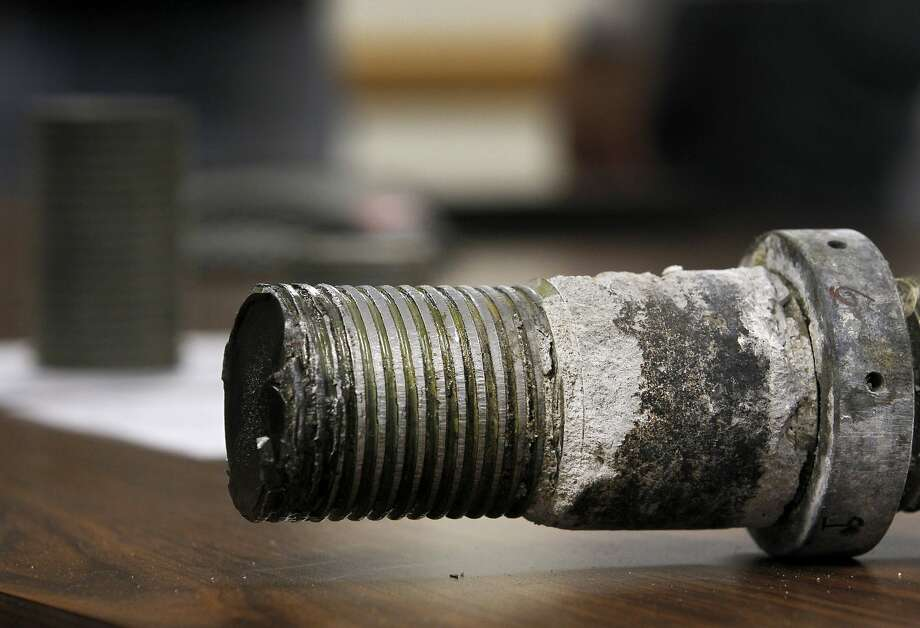 Caltrans engineers display a three-inch rod which was found to be broken from the base of the SAS tower of the new Bay Bridge, during a news conference in Oakland, Calif. on Wednesday, May 20, 2015. The rod was removed from the tower and will be sent to a lab for analysis. Photo: Paul Chinn, The Chronicle
