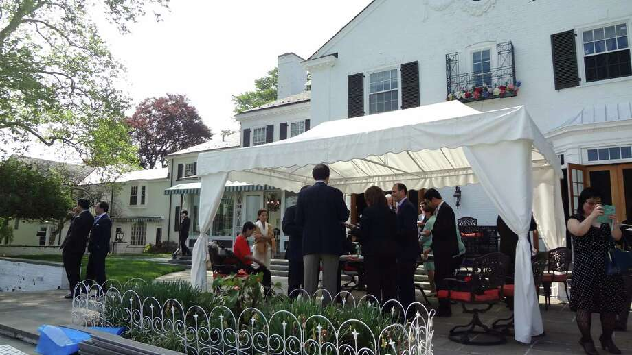 Potential property buyers from China scout Donald Trump's onetime mansion on May 20, 2015, at 21 Vista Drive in Greenwich, Conn. Photo: Alexander Soule / Stamford Advocate