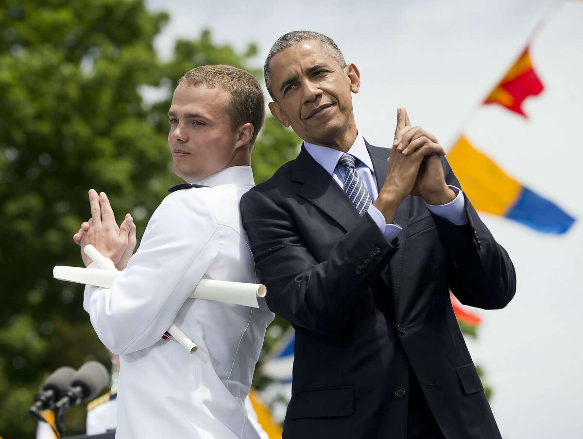 President Barack Obama and Ensign Robert Huntley McConnel strike a pose after he received his diploma and commission at the U.S. Coast Guard Academy graduation, Wednesday, May 20, 2015, in New London, Conn. (AP Photo/Pablo Martinez Monsivais)