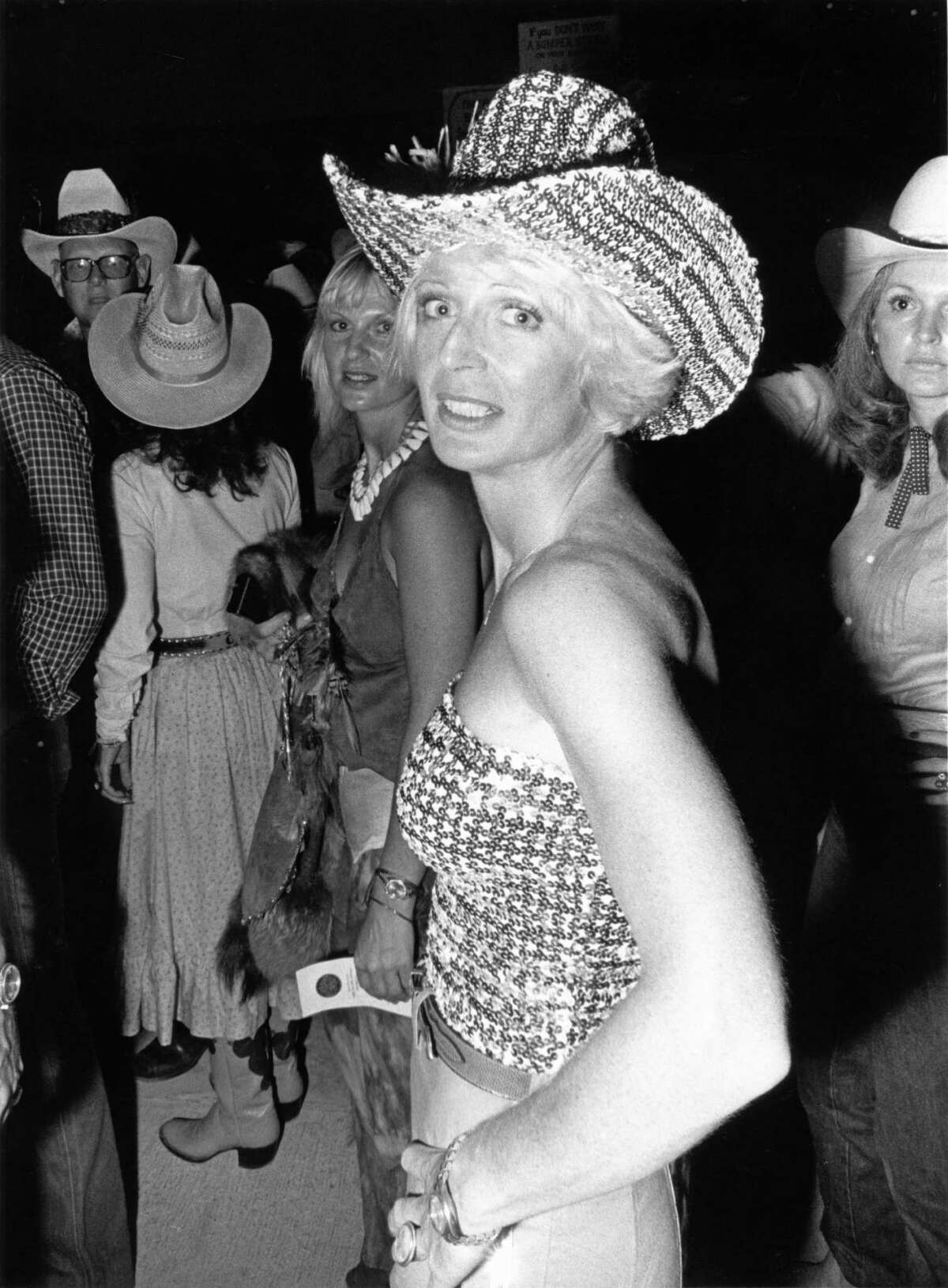 """06/05/1980 - Sequined cowgirl at Houston movie premiere party for """"Urban Cowboy"""" at Gilley's club."""