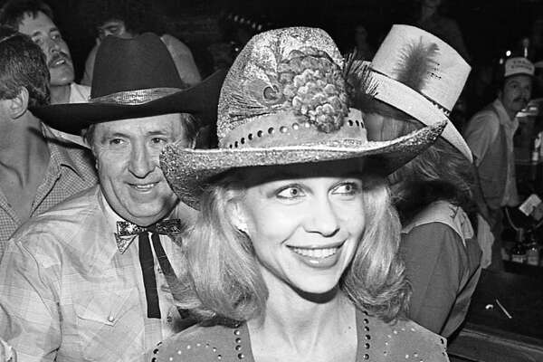 "06/05/1980 - Oscar and Lynn Wyatt at Houston movie premiere party for ""Urban Cowboy"" at Gilley's club."