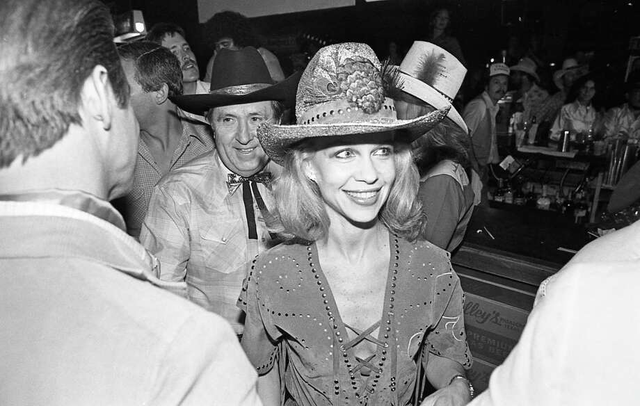 """06/05/1980 - Oscar and Lynn Wyatt at Houston movie premiere party for """"Urban Cowboy"""" at Gilley's club. Photo: Larry Reese, File / Houston Chronicle"""