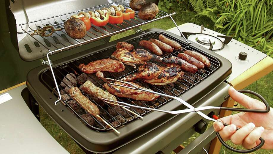 A gas grill allows variable heating options to cook several foods at once. Photo: Courtesy Photo / Handout