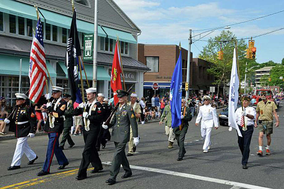 A military honor guard, representing all branches of the U.S. armed services, will again march in tribute to fallen service men and women during Monday's Memorial Day parade. Photo: File Photo / Westport News