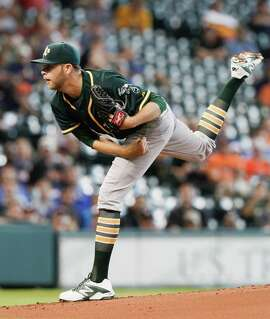 HOUSTON, TX - MAY 20:  Jesse Hahn #32 of the Oakland Athletics throws in the first inning against the Oakland Athletics at Minute Maid Park on May 20, 2015 in Houston, Texas.  (Photo by Bob Levey/Getty Images)