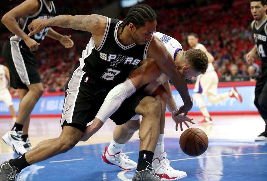 Kawhi Leonard of the Spurs and battles the Clippers' Blake Griffin for a loose ball during Game 7 of the Western Conference quarterfinals on May 2, 2015. Photo: Stephen Dunn /Getty Images / 2015 Getty Images