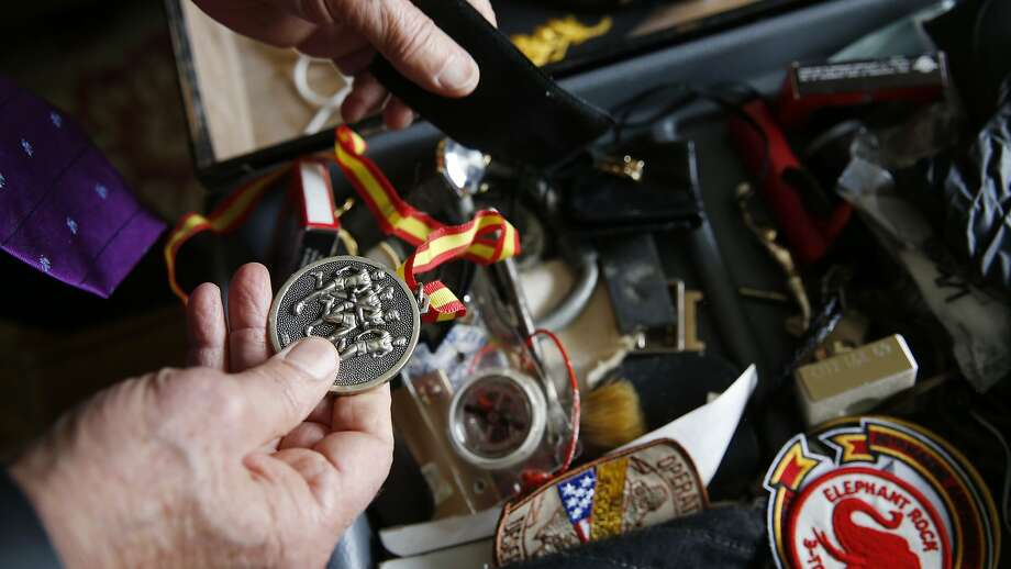 For the first time since he retired 20 years ago, Marine Corp Major General Mike Myatt investigates to contents of his footlocker in his home on Monday May 20, 2015 in san Francisco, Calif. Photo: Mike Kepka, The Chronicle