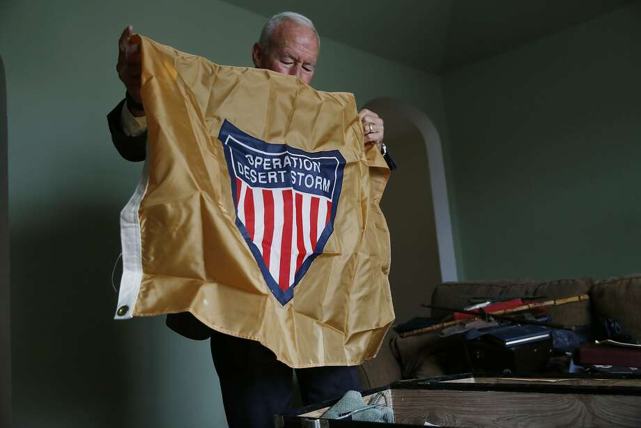 "After opening his footlocker for the first time since he retired 20 years ago, Marine Corp Major General Mike Myatt shows an ""Operation Desert Storm"" flag on Monday May 20, 2015 in san Francisco, Calif. Photo: Mike Kepka, The Chronicle"