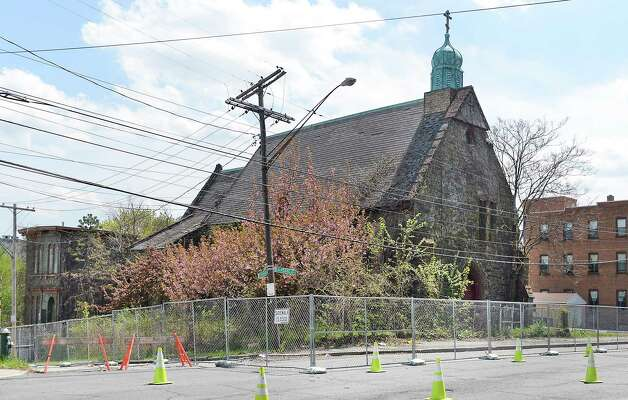 The long-shuttered former Church of the Holy Innocents in Arbor Hill is fenced off after part of it collapsed Monday on N. Pearl Street Tuesday May 5, 2015 in Albany, NY.  (John Carl D'Annibale / Times Union) ORG XMIT: MER2015050514193299 Photo: John Carl D'Annibale / 00031721A