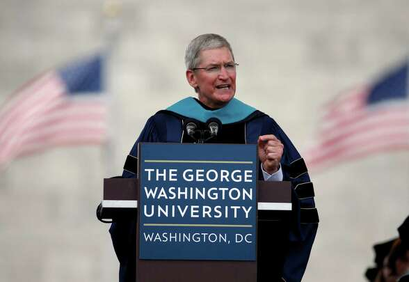 Apple CEO Tim Cook speaks to graduates during George Washington University's commencement exercises on the National Mall, Sunday, May 17, 2015 in Washington. The university awarded Cook with an honorary doctorate of public service. (AP Photo/Alex Brandon)