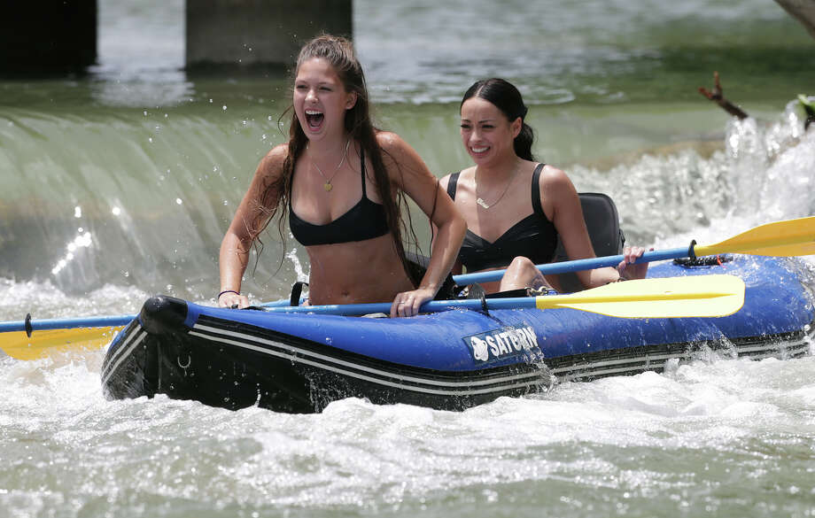 Madeline Juneau thrills in the white water below a waterfall with her friend Madeline Borrego (right) aboad as water flow on the Guadalupe River is steady before the Memorial Day weekend with a few recreationalists out on May, 20, 2015. Photo: Tom Reel / San Antonio Express-News