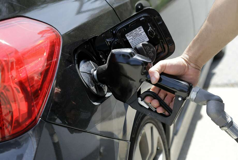 Even though cheaper gas has is putting more money in their pockets, most people have been reluctant to spend it because they view it as fleeting. Photo: Elise Amendola, Associated Press