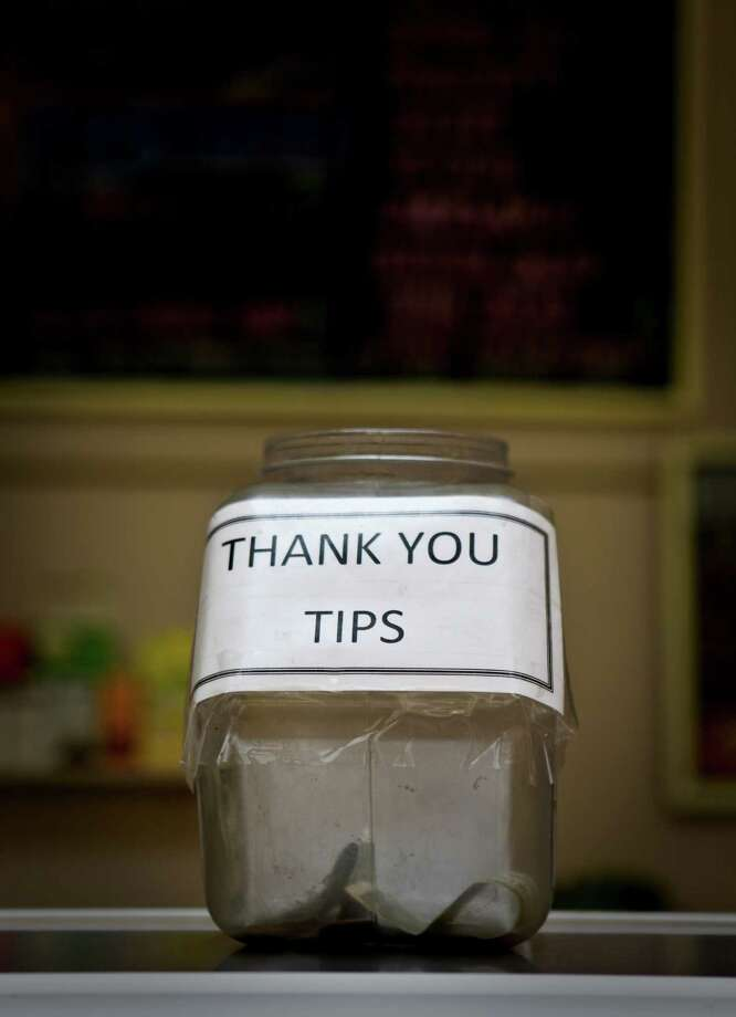 The tip jar at Arguello Super Market in San Francisco, Calif. is seen on Wednesday, Feb. 24, 2010. Photo: Russell Yip / The Chronicle / SFC