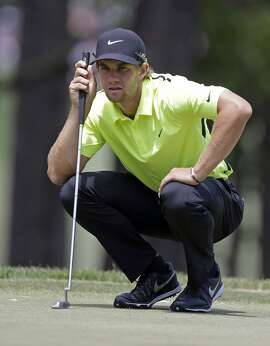 Patrick Rodgers lines up a putt on the first hole during the final round of the Wells Fargo Championship golf tournament at Quail Hollow Club in Charlotte, N.C., Sunday, May 17, 2015. (AP Photo/Bob Leverone)