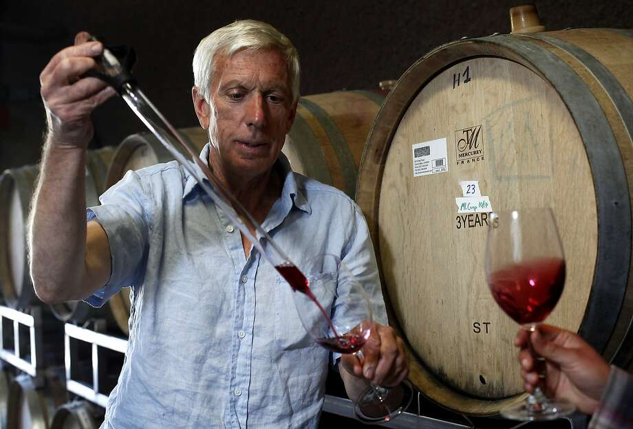 Winemaker Greg Vita pulls a sample from one of the barrels at Holman Ranch Winery to taste in Carmel Valley, Calif., on Friday, May 15, 2015. Photo: Sarah Rice