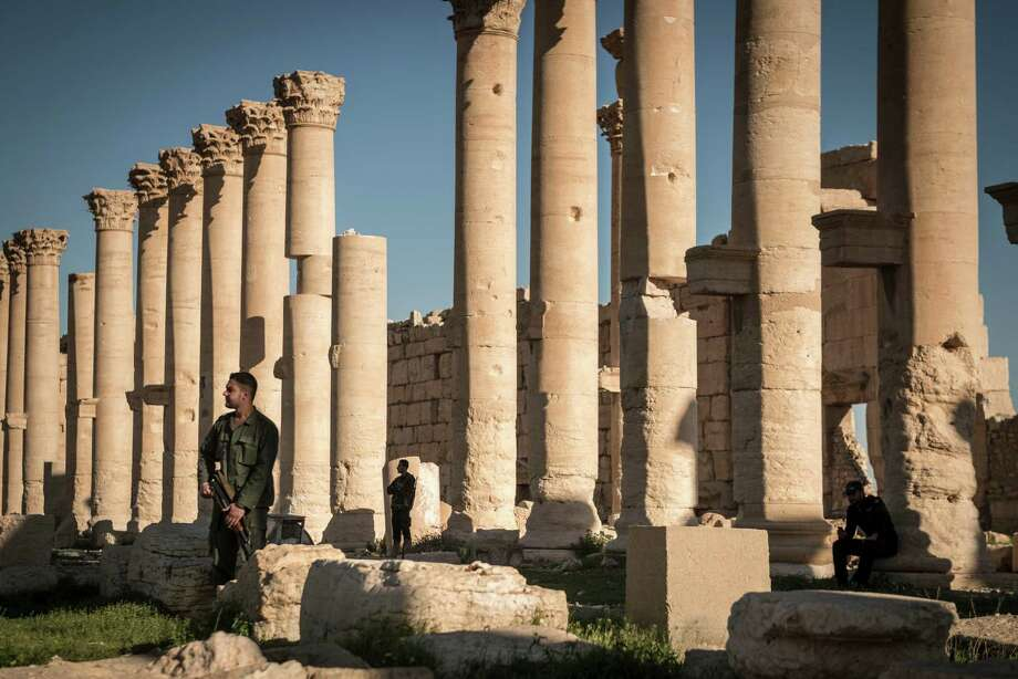 Syrian soldiers position themselves among columns at the Temple of Bel, an ancient stone ruin in Palmyra, Syria, last year. Photo: New York Times / NYTNS