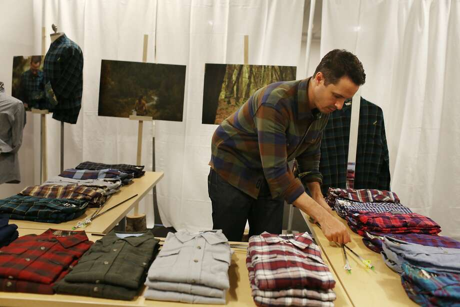 Scott Ellison of Pladra gets ready to open; Pladra's plaid shirts have been doing well online. Photo: Lea Suzuki, The Chronicle