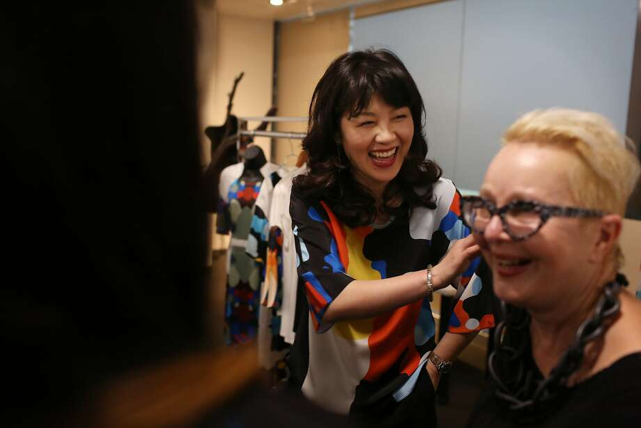 Above: Jessie Liu (left), Simple Pair designer, talks with Jeanne Allen, executive director of the fashion incubator. Photo: Lea Suzuki, The Chronicle