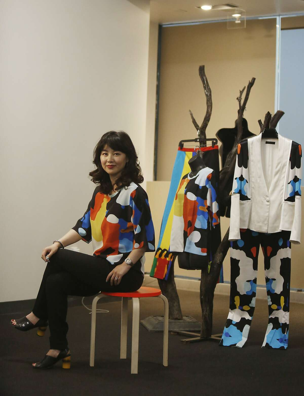 Jessie Liu, Simple Pair designer; poses with some of her designs in the new