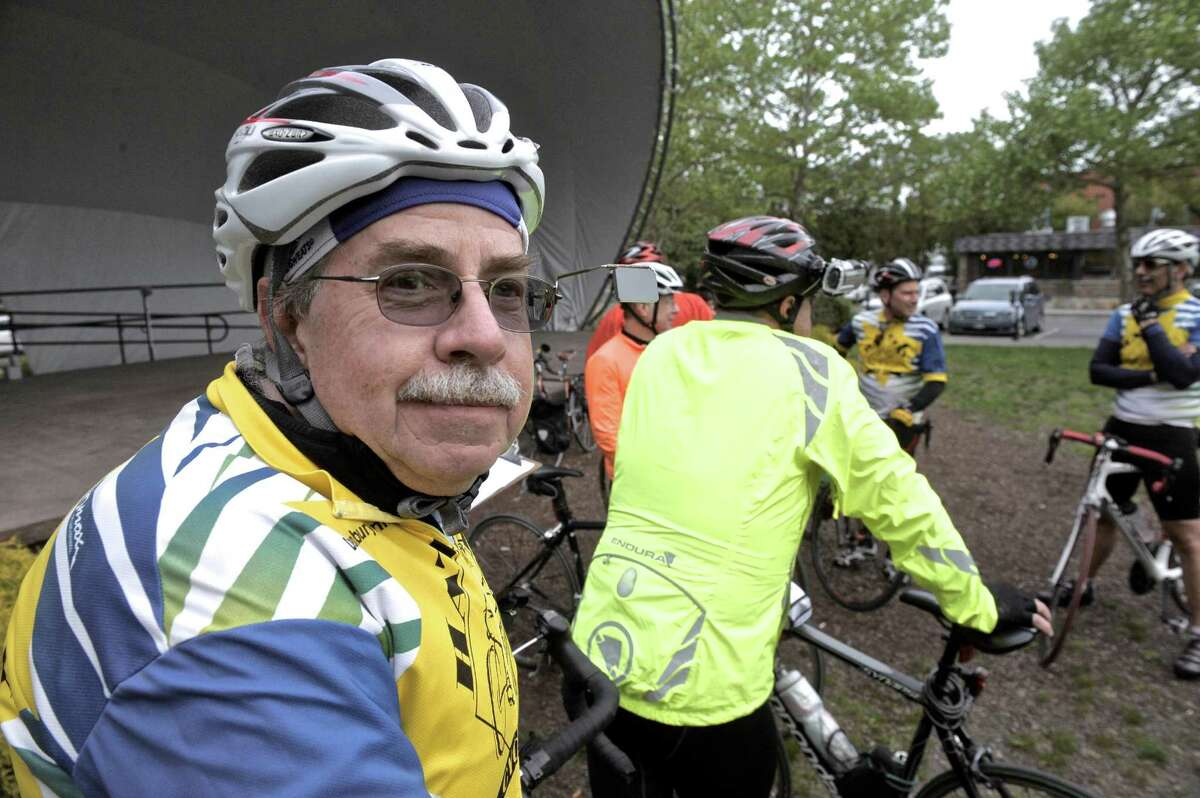 Roger Snow, of Danbury, waits at the Danbury Green, to participate in the Ride of Silence, a national event to raise awareness of sharing the road with cyclist, and honor cyclist who have been killed or injured. On Wednesday evening, May 20, 2015, in Danbury, Conn. Snow was hit by a car while riding in Redding on April 1st, he had broken bones in his leg, hand and ribs.