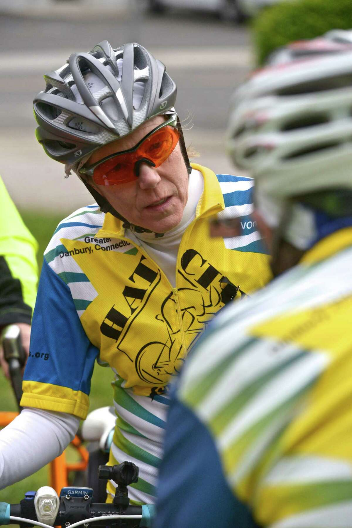 Leslie Bardelli, of New Milford,, talks with other riders as they wait at the Danbury Green, to participate in the Ride of Silence, a national event to raise awareness of sharing the road with cyclist, and honor cyclist who have been killed or injured. On Wednesday evening, May 20, 2015, in Danbury, Conn.