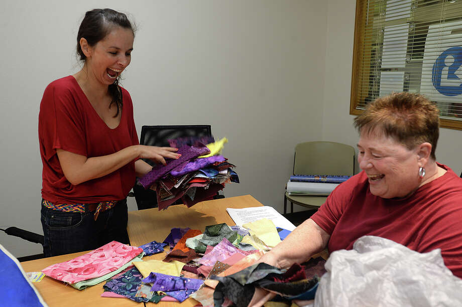 Angelica Sanchez and instructor Noel Ann McCord joke as they pack away fabric swatches at the end of the weekly meeting of the Stitch and Share group at Miller Library Wednesday night. The quilting group started two months ago and will continue as long as attendance and interest dictates. The women are working on a community project and hope to complete five lap quilts which will be donated to a local hospice. As the group continues, additional community service projects will be completed. Photo taken Wednesday, May 20, 2015 Kim Brent/The Enterprise Photo: Kim Brent / Beaumont Enterprise