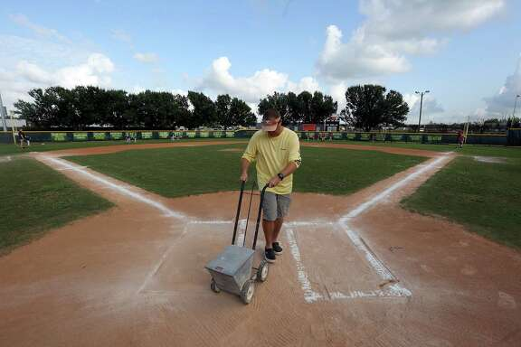 Byron Oujes limes the field on Wednesday for games - without showers - at the Dad's Club in Pearland.