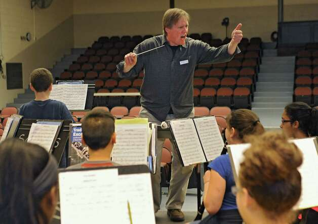 "Composer Kevin Mixon of Syracuse works with 7th grade band members who are rehearsing one of his pieces, ""Junkyard Jam,"" for a concert on May 28 at Sand Creek Middle School on Wednesday, May 20, 2015 in Colonie, N.Y. (Lori Van Buren / Times Union) Photo: Lori Van Buren / 00031920A"
