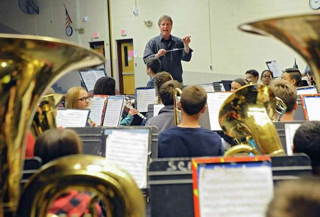"""Composer Kevin Mixon of Syracuse works with 7th grade band members who are rehearsing one of his pieces, """"Junkyard Jam,"""" for a concert on May 28 at Sand Creek Middle School on Wednesday, May 20, 2015 in Colonie, N.Y. (Lori Van Buren / Times Union) Photo: Lori Van Buren / 00031920A"""