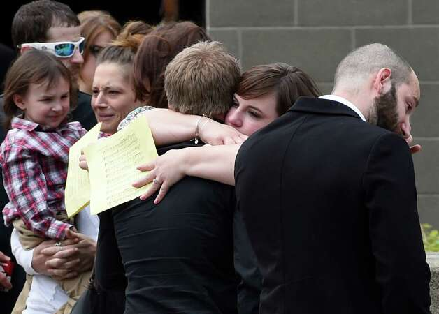Mourners of Los Angles Police Department shooting victim Brendon Glenn show their emotions outside the  Rensselaer Polytechnic Institute Cultural Center Wednesday afternoon May 20, 2015 after the funeral ceremony in Troy, N.Y.       (Skip Dickstein/Times Union) Photo: SKIP DICKSTEIN / 00031925A