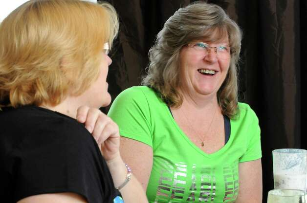 Tami McDonald of Albany, left, and her sister Jill Sharp talk about the heart disease they fear they inherited  Wednesday, May 13, 2015, during an interview at Jill's home in Westerlo, N.Y. (Lori Van Buren / Times Union) Photo: Lori Van Buren / 00031771A