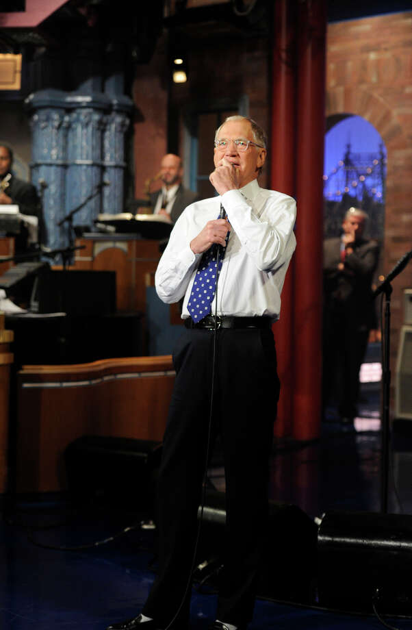 "In this image released by CBS, David Letterman appears during a taping of his final ""Late Show with David Letterman,"" Wednesday, May 20, 2015 at the Ed Sullivan Theater in New York. After 33 years in late night television, 6,028 broadcasts, nearly 20,000 total guest appearances, 16 Emmy Awards and more than 4,600 career Top Ten Lists, David Letterman is retiring. (Jeffrey R. Staab/CBS via AP) Photo: Jeffrey R. Staab, HONS / Associated Press / CBS ENTERTAINMENT"