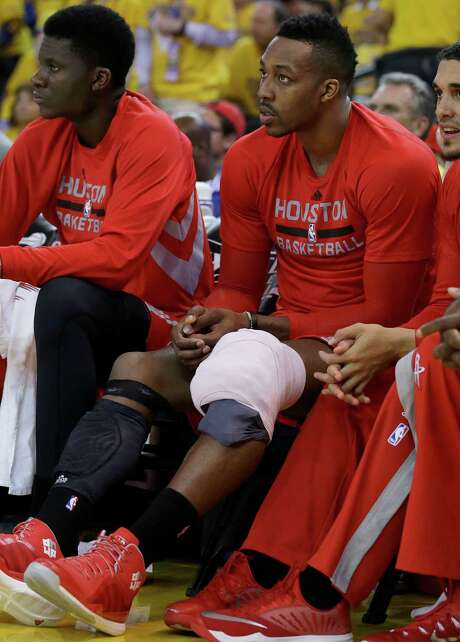 Rockets center Dwight Howard, right, sits on the bench with his knee wrapped during the second half of Game 1 of the Western Conference finals against the Warriors. Photo: Ben Margot / Ben Margot / Associated Press / AP