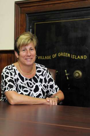 Green Island Mayor Ellen McNulty-Ryan poses for a photograph at the Green Island Village office in June 2013. The local school told Ryan to stop shooting her wildlife gun to scare off geese during school hours.    (Paul Buckowski / Times Union) Photo: Paul Buckowski / 00023150A