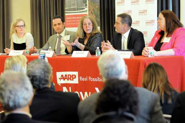 Diane Oakley, executive director of the National Institute of Retirement Security, center, speaks during an AARP sponsored panel discussion about retirement readiness on Wednesday, May 20, 2015, at the Albany Institute of History and Art in Albany, N.Y. Joining her, from left, are moderator Ashley Hupfl, Julian Federle, chief policy and programs officer; Thomas Nitido, deputy comptroller for New York State; and Sarah Mysiewicz Gill, senior legislative representative for AARP. (Cindy Schultz / Times Union) Photo: Cindy Schultz / 00031795A