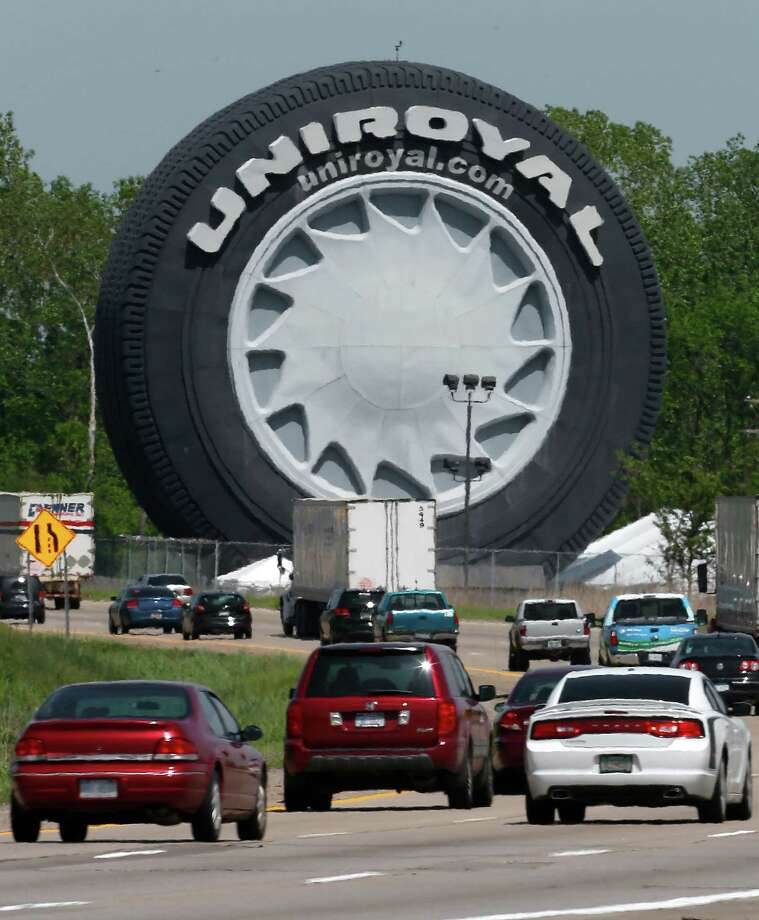 Traffic passes the Giant Uniroyal Tire on Interstate 94 in Allen Park, Mich., Wednesday, May 20, 2015. The 80-foot tall tire, which has stood alongside Interstate 94 near Detroit since 1965, is turning 50. The tire debuted at the New York World's Fair.  Photo: Paul Sancya, Associated Press / AP