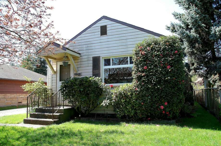 The first home, 9243 14th Ave. N.W., is listed for $399,000. The two bedroom, one bathroom home is a freshly painted rambler with a spacious backyard.   This home will be open for viewing on Saturday, May 23 and Sunday, May 24 from 1 - 4 p.m. You can see the full listing here.  Photo: Courtesy Of Darrin Stumpf