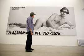 """Artist Hal Fischer looks at his """"A Salesman"""" mural as he visits as """"Gay Semiotics"""" is installed at Ratio 3 Gallery in the Mission District of San Francisco, Calif., on Wednesday, May 20, 2015."""