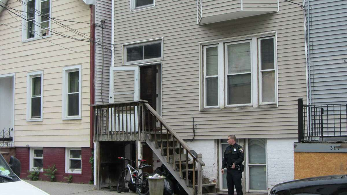 Albany police remained at the scene of an overnight homicide inside an apartment at 369 First St. Neighbors said a man died inside the building. (Bob Gardinier / Times Union)