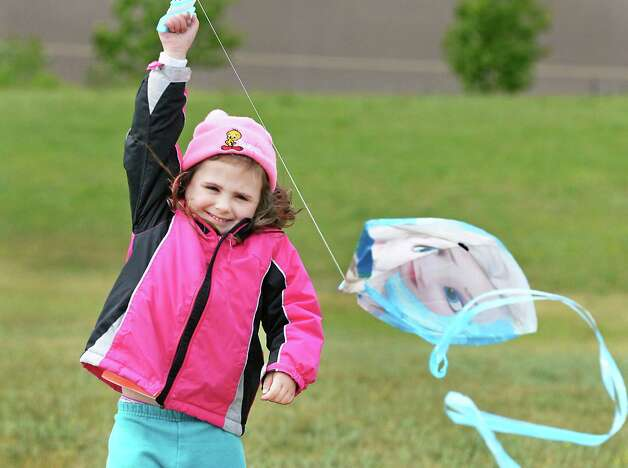 "Four-year-old Payton Schultz of Colonie takes advantage of  windy weather to fly her ""Frozen"" kite at the Crossings Wednesday May 20, 2015, in Coloine, NY.  (John Carl D'Annibale / Times Union) Photo: John Carl D'Annibale"