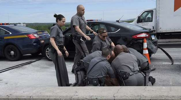 A police chase in Rensselaer County came to an end when state troopers stopped a fleeing motorist on the Patroon Island Bridge late Thursday morning. The chase stretched from at least Schodack to the bridge over the Hudson River. It ended at about 11:15 a.m. (Skip Dickstein / Times Union)