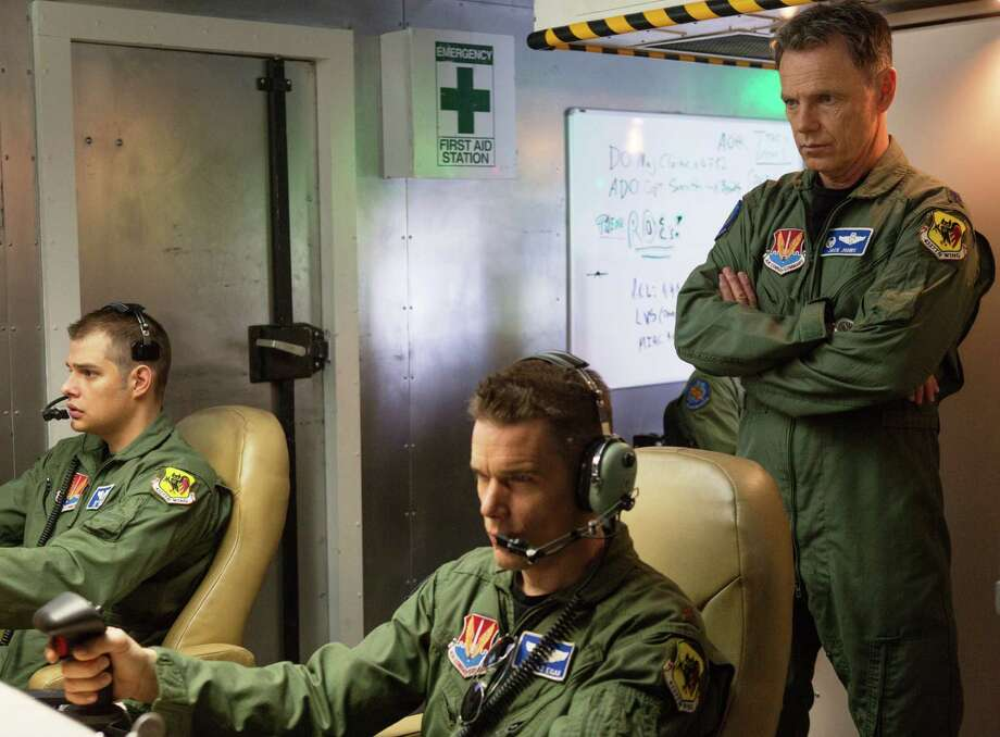 "Ethan Hawke, right, plays a drone pilot in ""Good Kill."" Photo: IFC Films"