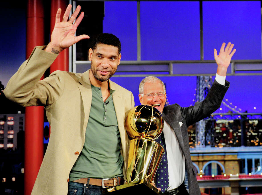 Tim Duncan, the Larry O'Brien Trophy and David Letterman shared the Late Show stage last summer. Photo: John Paul Filo / Associated Press / CBS